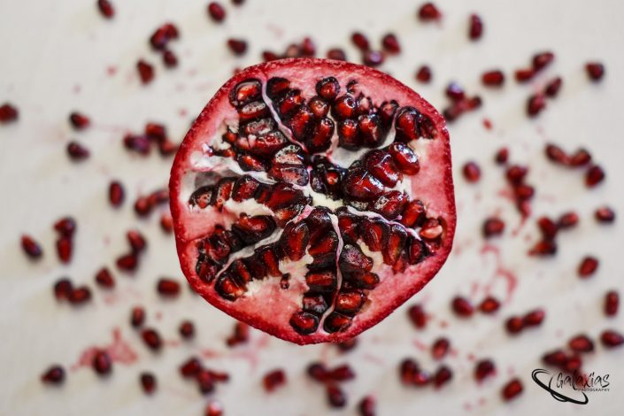 Flat Lay view of a opened pomegranate.