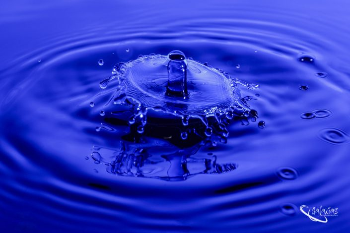 Water drop splash in blue